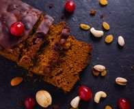 Baked Plum Cake On Stone Background With Dry Fruits. Baked Plum Cake On Kitchen Black Stone Background Baked Plum Cake On Stone Background With Dry Fruits royalty free stock image