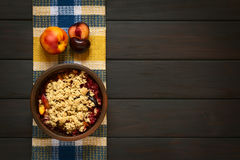 Baked Plum and Nectarine Crumble Stock Images
