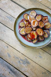 Baked plums Stock Photo