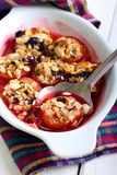 Baked plums with muesli crumble topping Royalty Free Stock Image
