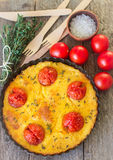 Baked polenta with tomatoes Stock Image