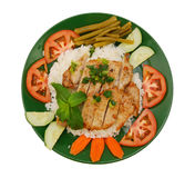 A baked pork chop with rice Stock Photography
