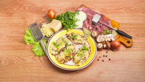 Baked pork chops with cheese and ingredients for their preparati Royalty Free Stock Photo
