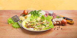 Baked pork chops with cheese and ingredients for their preparati Stock Photo