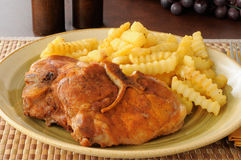 Baked pork chops and fries Royalty Free Stock Photo