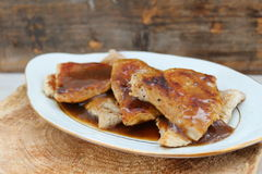 Baked pork chops with gravy. Lunch made with pork chops and gravy Royalty Free Stock Photos