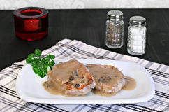 Baked pork chops with mushroom gravy. Royalty Free Stock Photos
