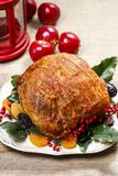 Baked pork with dried apricots on christmas table. Festive dish Stock Photo