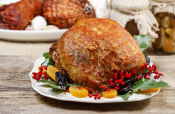 Baked pork with fruits on wooden table. Stock Images