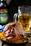 The baked pork gammon with sauerkraut Stock Photos