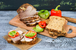 Baked pork loin with garlic and vegetables Stock Photos