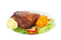 Baked pork meat with chill and lemon Royalty Free Stock Photo