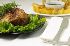 Baked Pork Meat served with Grilled Potato. And sauce Stock Photo