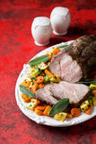 Baked pork meat with vegetables Stock Images