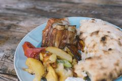 Baked pork with potato and homemade bread Royalty Free Stock Image