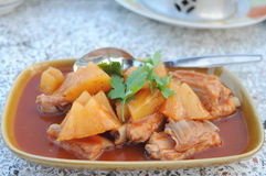 Baked pork rib mixed pineapple in tomato sauce. Delicious of thaifood Stock Photo