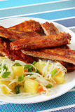 Baked pork ribs with potato salad Stock Photography