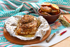 Baked pork on round board. Royalty Free Stock Image