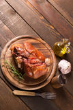 Baked pork shank. On wooden table with free space for text Royalty Free Stock Image