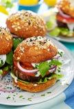 Baked portobello mushroom burger with addition fresh lettuce, tomato, onion and herb yogurt dip Stock Photo