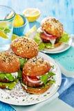 Baked portobello mushroom burger with addition fresh lettuce, tomato, onion and herb yogurt dip Royalty Free Stock Photo