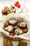 Baked Portobello mushrooms stuffed with cheese and vegetables. Delicious and nutritious vegetarian dish with organic products Stock Photo