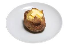 Baked Potato. With melting butter, isolated on white. Short DOF Royalty Free Stock Image