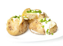 Baked potato. Delicious baked potatoes on a white background Stock Photography