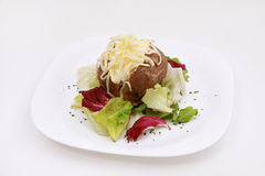 BAKED POTATO. With vegetables and cheese Stock Photography
