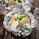 Baked potato. Fresh baked potato with curd and chive royalty free stock photos