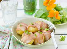 Baked potato in bacon Stock Images