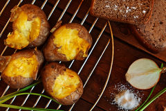 Baked potato with bread and onions Stock Photos