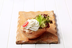 Baked potato with cheese Royalty Free Stock Image