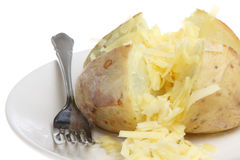 Baked Potato with Cheese. Baked potato with grated Cheddar cheese Royalty Free Stock Photo