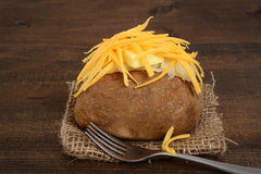 Baked potato with cheese and butter Stock Photography