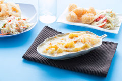 Baked potato with cheese, Potatoes Gratin. 