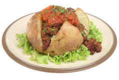 Baked Potato with Chili & Salsa. Baked potato filled with chilli con carne and tomato salsa Royalty Free Stock Photography