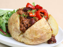 Baked Potato with Chilli. Jacket potato filled with chilli Stock Photography