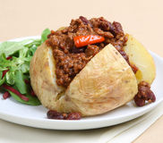 Baked Potato with Chilli. Jacket potato stuffed with Chilli con Carne Royalty Free Stock Photos