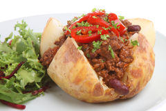 Baked Potato with Chilli. Jacket potato filled with chilli con carne Royalty Free Stock Images