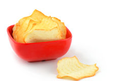 Baked potato chips. Healthy low fat baked potato chips in square red bowl, single serving Stock Images