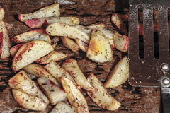 Baked potato - cooking. Meat dishes complement the roast potatoes Royalty Free Stock Image