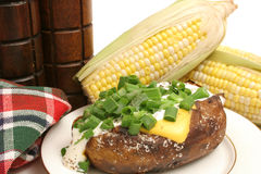 Baked potato & corn on the cob Royalty Free Stock Photography