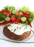 Baked potato and cottage cheese vertical Royalty Free Stock Photography