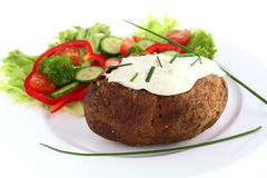 Baked potato and cream cheese Royalty Free Stock Photography