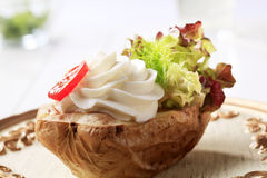 Baked potato and cream cheese Stock Images
