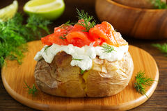 Baked potato with cream of the cream cheese and salted salmon, Royalty Free Stock Photography