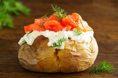 Baked potato with cream of the cream cheese and salted salmon, Stock Image