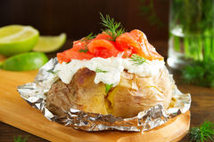 Baked potato with cream of the cream cheese and salted salmon, Royalty Free Stock Image
