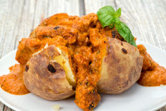 Baked potato filled with Chicken Tika Masala curry Royalty Free Stock Images